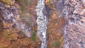 Beautiful autumn alpine landscape with Zmuttbach creek near Zermatt stock video
