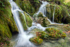 Beautiful autumn creek with a little cascade Royalty Free Stock Photography