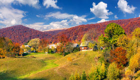 Beautiful autumn day in mountains village Stock Images