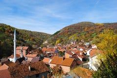 Beautiful autumn day in mountains village. Colorful autumn landscape in the mountain village. Shar Mountain, southern Kosovo Royalty Free Stock Photo