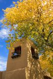 A beautiful autumn day in Santa Fe. This beautiful autumn day, with bright yellow cottonwood leaves, rich blue sky and warm adobe architecture is the perfect Royalty Free Stock Photos