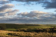 Beautiful Autumn Fall landscape of South Downs National Park in English countryside in late afternoon light. On cold day royalty free stock image