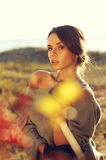 Beautiful autumn female. Young pretty woman standing in autumn yellow colours field and looking at you charming. beautiful portraits made with backlit Royalty Free Stock Photo