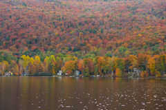 Beautiful autumn foliage and cabins in Elmore state park, Vermont Royalty Free Stock Photography