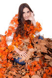 Beautiful autumn girl covered with  leaves Royalty Free Stock Images