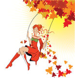 Beautiful autumn girl on swing Stock Photo