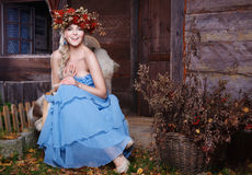 Beautiful autumn girl with wreath on head. Outdoor royalty free stock images