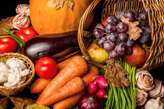 Beautiful autumn harvest. Of vegetables and leaves on black background Stock Photo