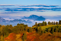 Beautiful Autumn landscape with cloud inversion Royalty Free Stock Images