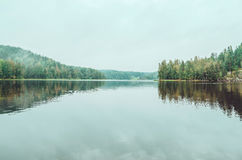 Beautiful autumn landscape with lake, pine trees, natural stone coast in the Republic of Karelia, Ladoga , northern Royalty Free Stock Photo