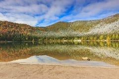 Beautiful autumn landscape,Saint Anna lake,Transylvania,Romania. Colorful snowy forest and clean lake,St Ana lake,Transylvania,Romania Royalty Free Stock Image