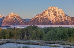 Scenic Autumn Sunrise Landscape in the Tetons. A beautiful autumn landscape in the Tetons at sunrise Royalty Free Stock Images