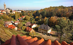 Beautiful autumn landscape of a valley with a small old city in Europe. Beautiful landscape lit by the autumn sun valley with a small old European city, a hotel Stock Image