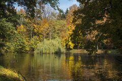 Beautiful autumn Lazienki Krolewskie park in Warsaw, Poland Royalty Free Stock Photography