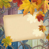 Beautiful autumn leaves ower wooden planks. Beautiful autumn leaves with paper card and copy space for text stock photo