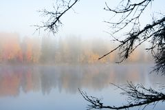Beautiful autumn morning landscape of Kymijoki river waters in fog. Finland, Kymenlaakso, Kouvola.  royalty free stock photo