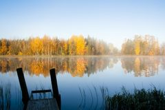 Beautiful autumn morning landscape of Kymijoki river waters and pier in fog. Finland, Kymenlaakso, Kouvola.  stock photography
