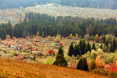 Beautiful autumn mountain and the village Stock Photos