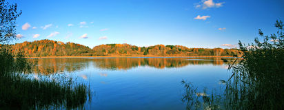 Beautiful autumn panoramic landscape of lake stock image