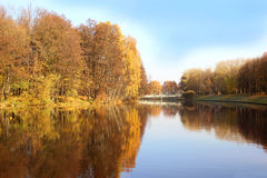 Beautiful autumn park. Autumn in Minsk. Autumn trees and leaves. Autumn Landscape.Park in Autumn. Mirror reflection of trees in wa Royalty Free Stock Images