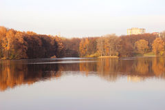 Beautiful autumn park. Autumn in Minsk. Autumn trees and leaves. Autumn Landscape.Park in Autumn. Mirror reflection of trees in wa Royalty Free Stock Photos