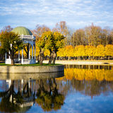 Beautiful autumn park with golden trees and little pond Royalty Free Stock Image