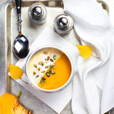 Beautiful autumn Pumpkin soup with cream in a white bowl with si Royalty Free Stock Images