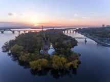 Aerial Flight over the Christian Church in the Monastic island, Dnepr City, Ukraine Dnipro, Dnepropetrovsk. Beautiful autumn on the River Dnieper, Christian royalty free stock photography