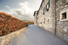 Beautiful autumn scene street. Street with old house / building and autumn leafs Stock Image
