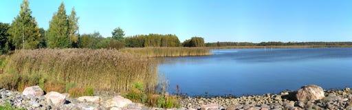 Beautiful autumn scenery panorama. Beautiful fall colors by seaside royalty free stock image