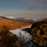 Beautiful autumn scenery. Of river, trees and mountains Royalty Free Stock Image