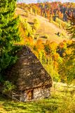 Beautiful autumn scenery with traditional straw roof house in Apuseni mountains, Transylvania. Romania Royalty Free Stock Images