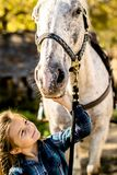 In a beautiful Autumn season of a young girl and horse royalty free stock image