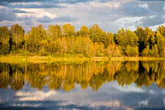 Beautiful autumn sunset at the lake with blue sky, red and orang Royalty Free Stock Photography