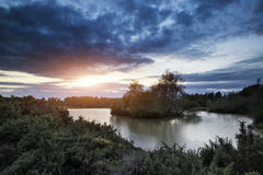 Beautiful Autumn sunset over lake landscape in forest Royalty Free Stock Photos