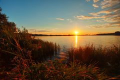 Beautiful autumn sunset over lake in Russia. Beautiful autumn sunset over the lake in Russia Royalty Free Stock Photo