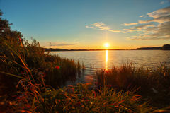 Beautiful autumn sunset over lake in Russia Stock Image