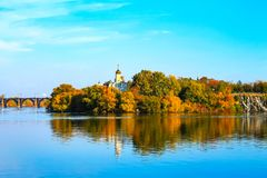 Beautiful autumn sunset on the River Dnieper, Christian Church in the Monastic island, Dnepr City, Ukraine. Dnipro, Dnepropetrovsk, Dnipropetrovsk stock photography