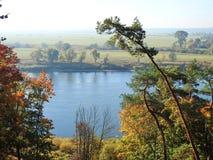 Beautiful autumn trees near river, Lithuania royalty free stock photo