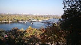 A beautiful autumn view of the pedestrian bridge stock video