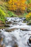 Beautiful autumn waterfall Stock Photos