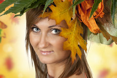 Beautiful autumn woman. With leaves Stock Photos