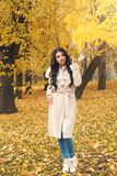 Beautiful autumn woman on fall yellow leaves background. Outdoor royalty free stock images