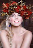 Beautiful autumn woman. With garland on several of rowan Royalty Free Stock Photography