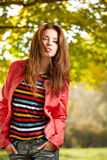 Beautiful autumn woman. In golden park Stock Photography