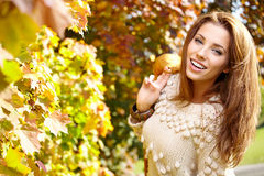 Beautiful autumn woman. In golden park Royalty Free Stock Image