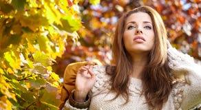 Beautiful autumn woman. In golden park Royalty Free Stock Photos