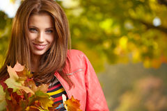 Beautiful autumn woman. In golden park Stock Images