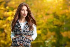 Beautiful autumn woman. In golden park Stock Image