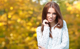 Beautiful autumn woman. In golden park Royalty Free Stock Photography